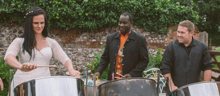 Steelasophical provided a Steel drum workshop for this unqiue wedding drinks reception at Monkton Barn. marlow. All of the guests + bride and Groom had the opportunity to play the steel drums .. it was a great hit!!