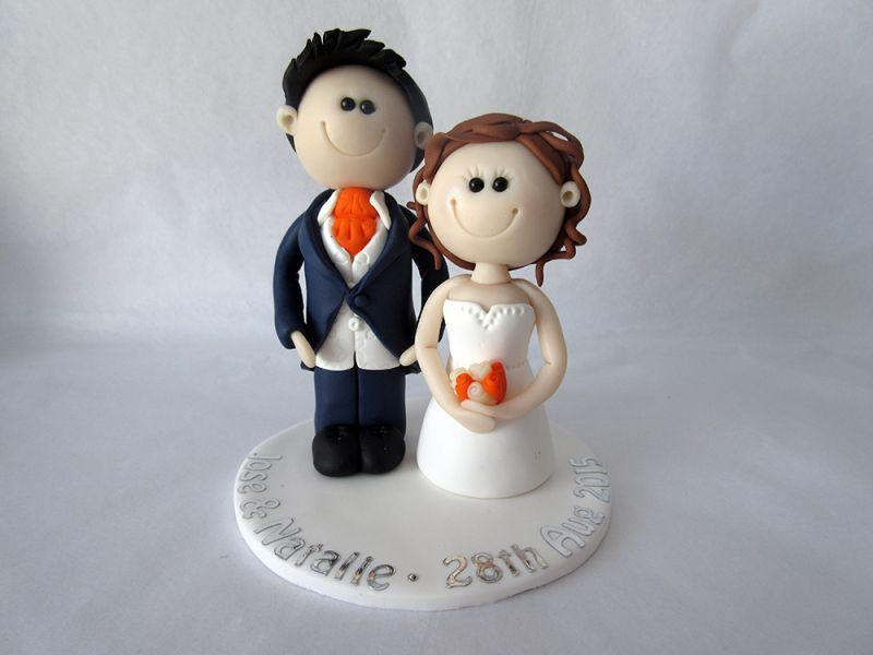 Custom made Personalised wedding cake toppers. Bride & Groom figures